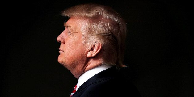 Republican U.S. presidential candidate Donald Trump poses for a photo after an interview with Reuters...