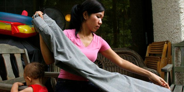 Susan, a 36-year-old maid from the Philippines, works at her employer's house in Singapore April 29,...