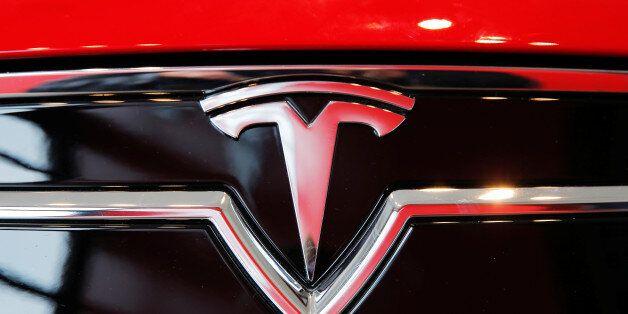A Tesla logo on a Model S is photographed inside of a Tesla dealership in New York, U.S., April 29, 2016....