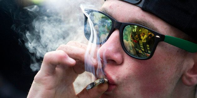 A man smokes a marijuana joint at the Vancouver Art Gallery during the annual 420 day to promote the...