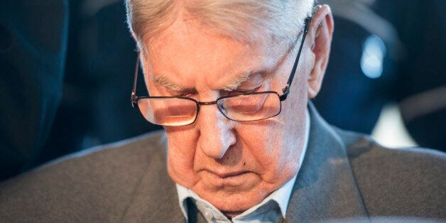 Defendant Reinhold Hanning, a 94-year-old former guard at Auschwitz death camp, arrives for the continuation...