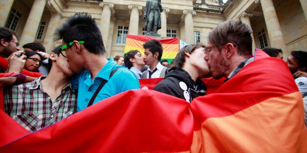 People kiss during a protest demanding the rights of the lesbian, gay, bisexual, and transgender (LGBT)...