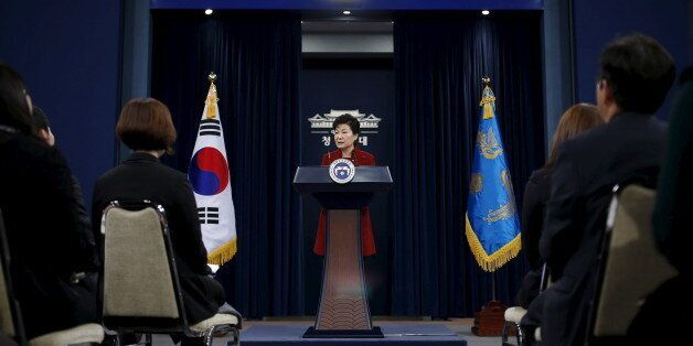 South Korean President Park Geun-hye answers reporters' question during her New Year news conference...
