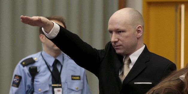 Mass killer Anders Behring Breivik raises his arm in a Nazi salute as he enters the court room in Skien...