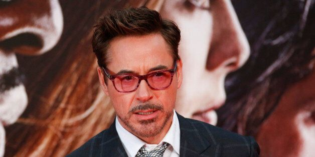 Actor Robert Downey Jr. poses before the German premiere