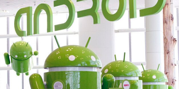 Android mascots are lined up in the demonstration area at the Google I/O Developers Conference in the...