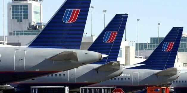 United Airlines aircraft are lined up at their gates at Denver International Airport, December 9, 2002....
