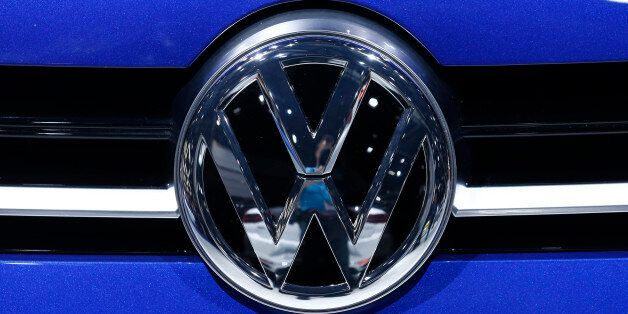A Volkswagen (VW) logo is pictured on a car on the company's booth during the second media day of the...