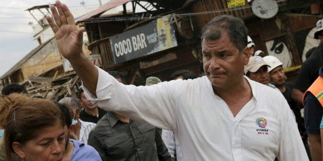 Ecuador's President Rafael Correa (R) greets residents during his visit after an earthquake struck off...