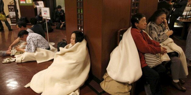 Hotel guests gather at the lobby after another earthquake hit the area in Kumamoto, southern Japan, in...