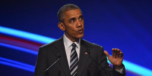 U.S. President Barack Obama gestures as he makes a speach during the opening ceremony of the Hannover...