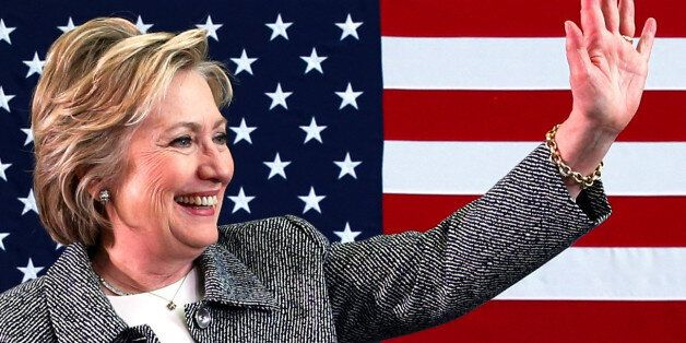 U.S. Democratic presidential candidate Hillary Clinton waves after leading a discussion on gun violence...