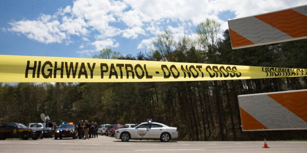 Police tape is deployed across from the Union Hill Road exit off Route 32 at a crime scene perimeter,...