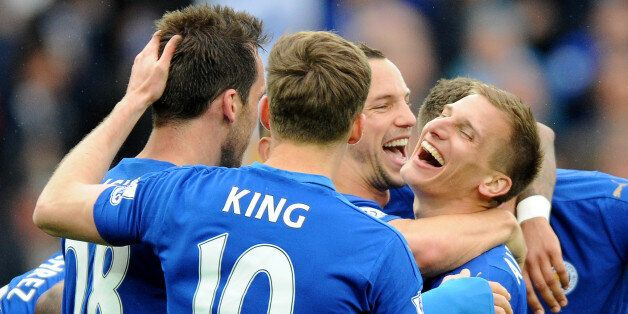 Leicester's Marc Albrighton, center right, celebrates with team mates after scoring against Swansea during...