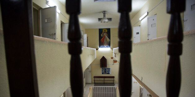 In this April 14, 2015 photo, a poster of Jesus hangs in the now empty Garcia Moreno Prison, during a...