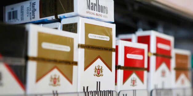 Packs of Marlboro cigarettes are displayed for sale at a convenience store in Somerville, Massachusetts...