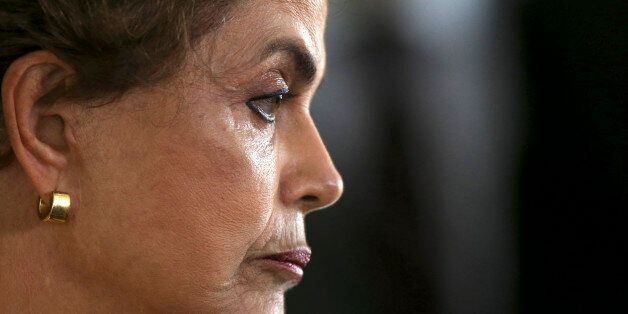 President Dilma Rousseff attends a news conference after visiting the new Embraer KC 390 military transport...