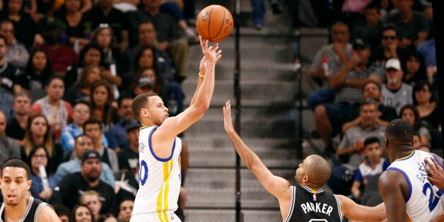 Apr 10, 2016; San Antonio, TX, USA; Golden State Warriors point guard Stephen Curry (30) shoots the ball...
