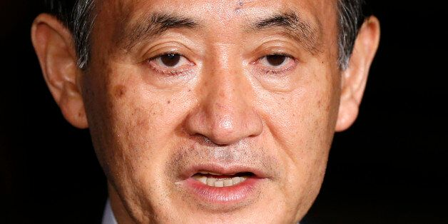 Japan's Chief Cabinet Secretary Yoshihide Suga speaks to the media at Prime Minister Shinzo Abe's official...