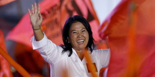 Peru's presidential candidate Keiko Fujimori of 'Fuerza Popular' party waves to supporters during her...