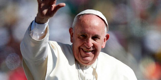 Pope Francis waves to the crowd while arriving to celebrate Mass in San Cristobal de las Casas, February...