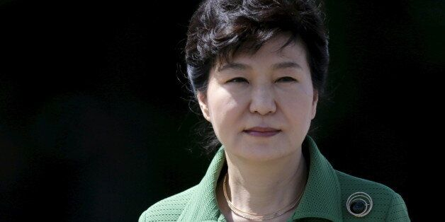 South Korea's President Park Geun-hye walks past an honor guard before a meeting with Brazil's President...