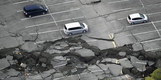 Cracks caused by an earthquake is seen at a parking lot in Minamiaso town, Kumamoto prefecture, southern...
