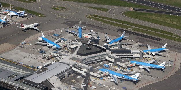 KLM aircraft are seen on the tarmac at Schipol airport near Amsterdam April 15, 2015. REUTERS/Yves