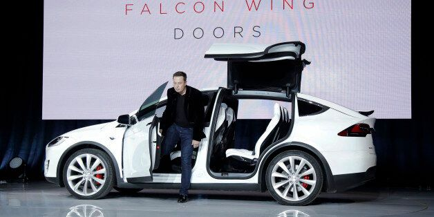 Elon Musk, CEO of Tesla Motors Inc., introduces the Model X car at the company's headquarters Tuesday,...