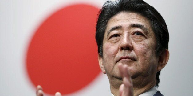 Japan's Prime Minister Shinzo Abe claps his hands during the ruling Liberal Democratic Party (LDP) annual...