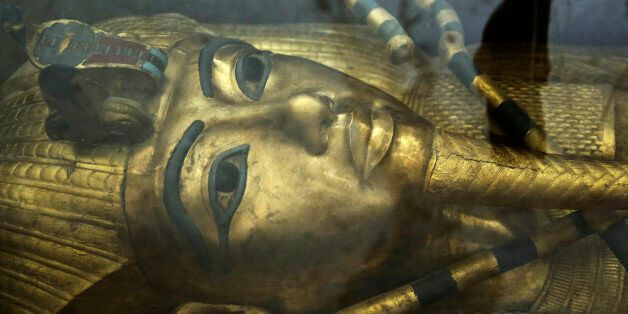 The tomb of King Tut is displayed in a glass case at the Valley of the Kings in Luxor, Egypt, Tuesday,...