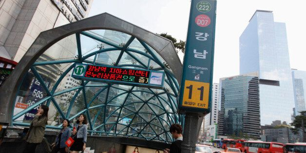 People come out at Gangnam subway station in the Gangnam area of Seoul October 2, 2012. Gangnam is the...