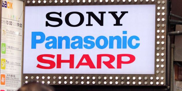 The brands' names of Japanese electronics makers, including Sharp, are displayed on a signboard of a...