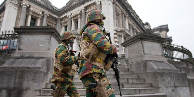 Belgium soldiers patrol around the main court building where Salah Abdeslam, the top suspect in last...