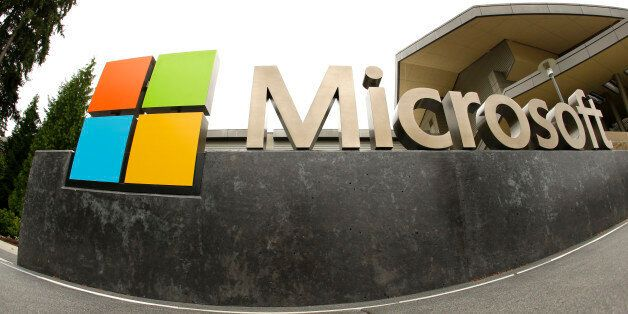 FILE - This July 3, 2014, file photo, shows the Microsoft Corp. logo outside the Microsoft Visitor Center...
