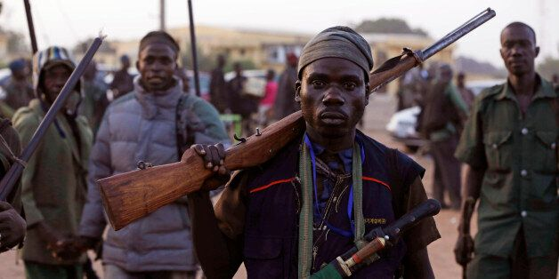 FILE-In this file photo taken on Wednesday, Nov. 25, 2014 file photo, vigilantes and local hunters armed...