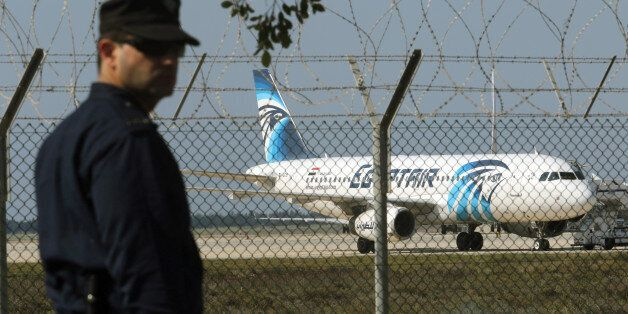 A policeman stands guard at Larnaca Airport near a hijacked Egyptair A320 , March 29, 2016. REUTERS/Yiannis