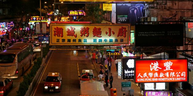 Colorful neon signs are lighted at Hong Kong's Wan Chai red light district Wednesday, Nov. 5, 2014. For...