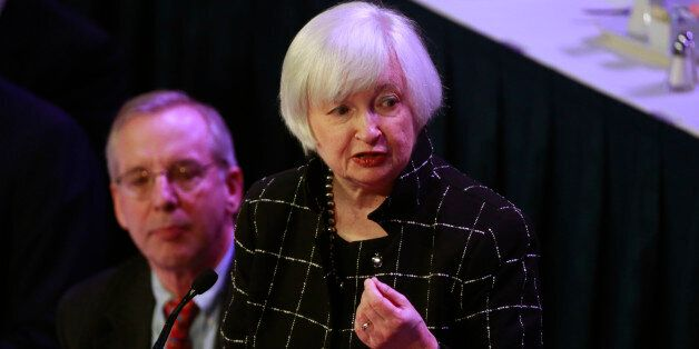 U.S. Federal Reserve chair Janet Yellen (R) is applauded before speaking to the Economic Club of New...