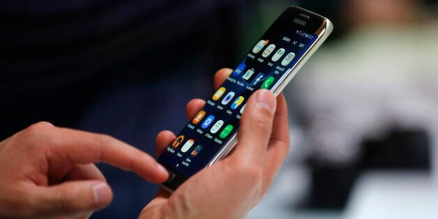 A man holds the Samsung Galaxy S7 Edge during the Samsung Galaxy Unpacked 2016 event on the eve of this...