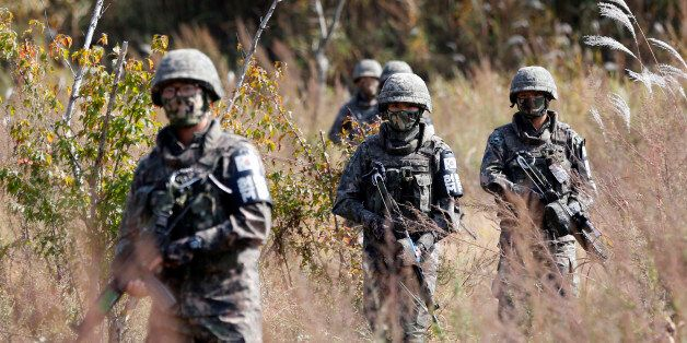 South Korean Army soldiers patrol during the demonstration of search operation at a training field near...
