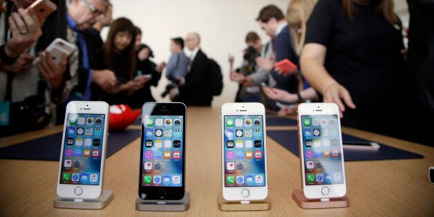 Members of the media and invited guests take a look at the new iPhone SE during an event at Apple headquarters...