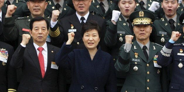 GYERYONG, SOUTH KOREA - MARCH 04: South Korean President Park Geun-Hye cheers with new military officers...