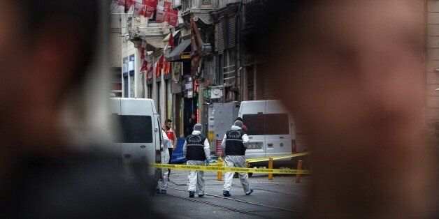 ISTANBUL, TURKEY - MARCH 19: Police secure the area as forensics inspects the blast site following a...