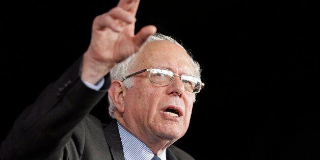Democratic presidential candidate, Sen. Bernie Sanders, I-Vt., gestures as he speaks to supporters during...
