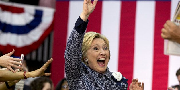 Democratic presidential candidate Hillary Clinton arrives to a cheering crowd to speak at a campaign...