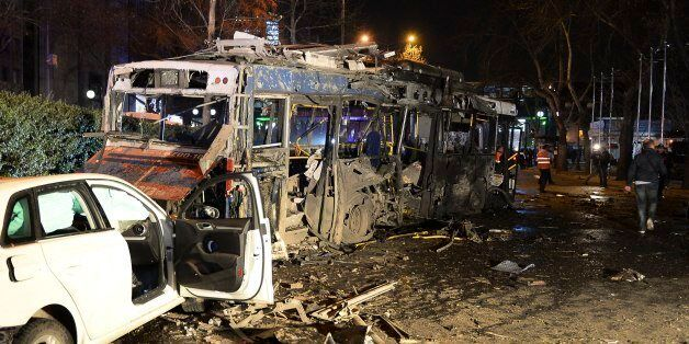 Damaged vehicles are seen at the scene of an explosion in Ankara, Turkey, Sunday, March 13, 2016. The...
