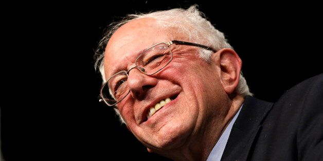 Democratic presidential candidate, Sen. Bernie Sanders, I-Vt., smiles during a campaign rally, Tuesday,...