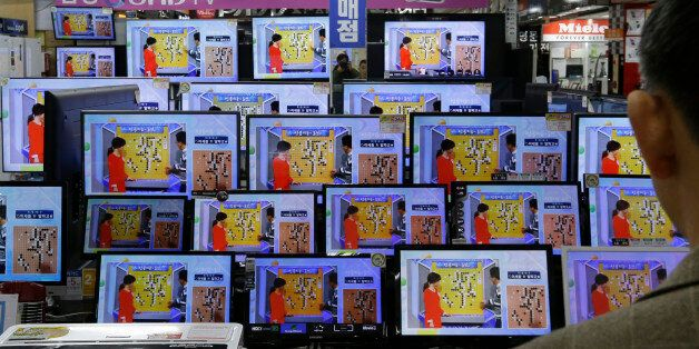 TV screens show the Google DeepMind Challenge Match at the Yongsan Electronic store in Seoul, South Korea,...