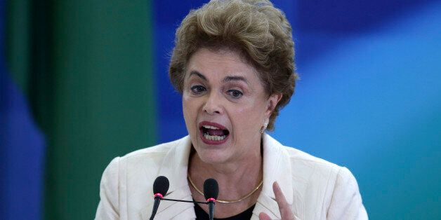 Brazil's President Dilma Rousseff speaks during a ceremony in which her predecessor, Luiz Inacio Lula...